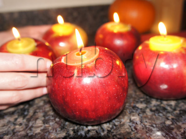 Diy halloween decorations how to make apple candles for Apple decoration ideas