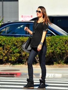 Model Alessandra Ambrosio also pairs her Isabel Marant sneakers with a complimentary Celine bag.