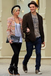 Ashlee Simpson was spotted wearing black Isabel Marant Perkins Suede and Leather Wedge Sneakers.