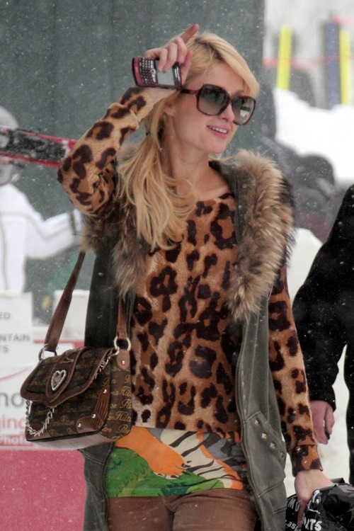 Paris Hilton poses for photographers as she heads home after a day on the snowy slopes of Aspen