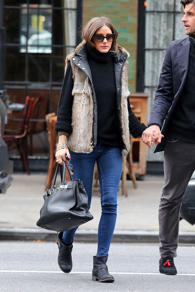 Olivia Palermo wearing a fur vest with skinny jeans, Hermes birkin bag, and black chunky Zadig & Voltaire sweater.