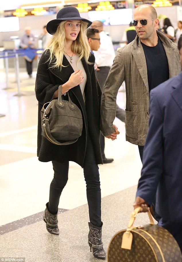Rosie-Huntington-Whiteley-Isabel-Marant-western-boots sweater coat givenchy bag traveling