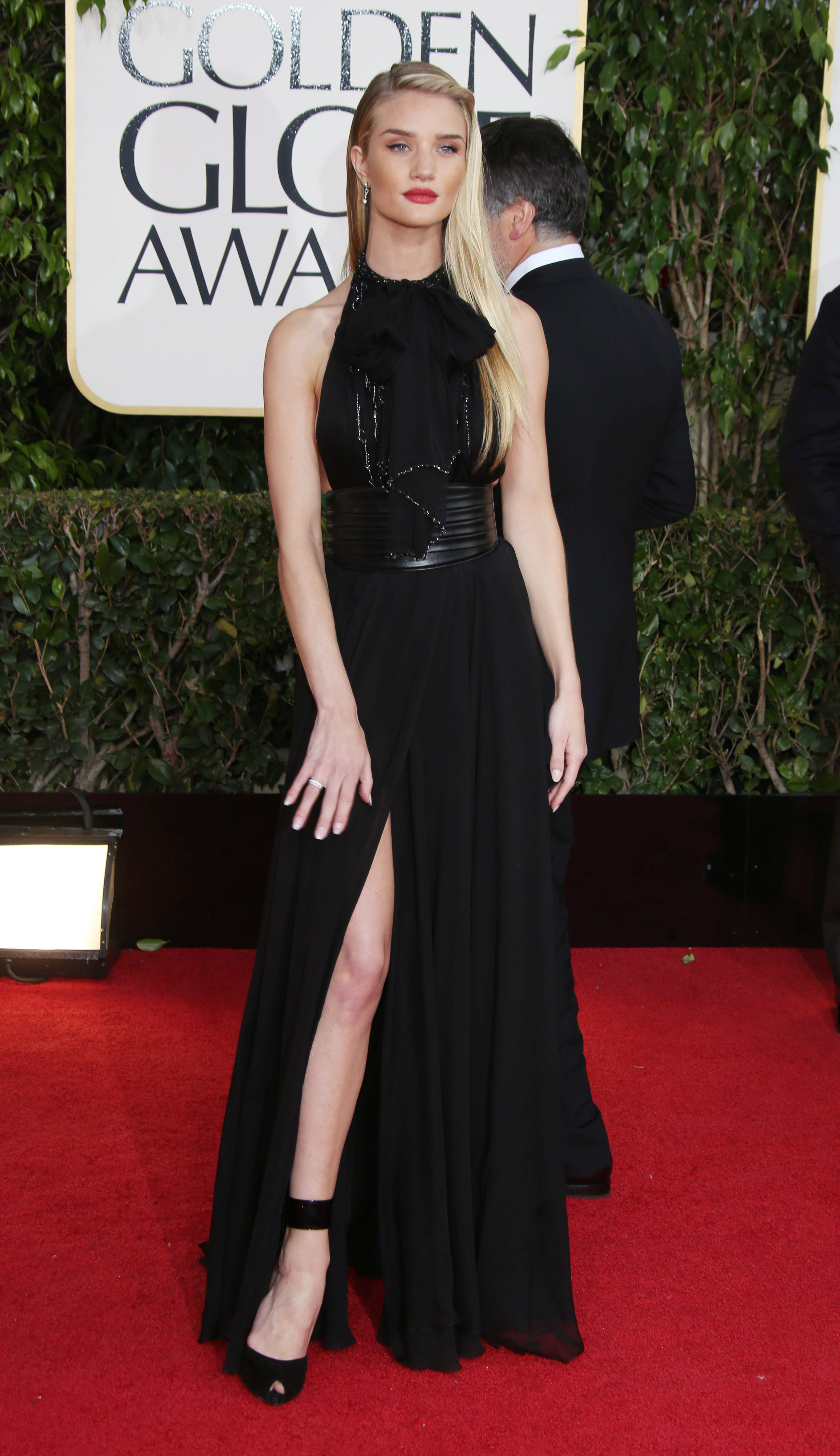 Rosie Huntington-Whiteley wearing a YSL high slit gown