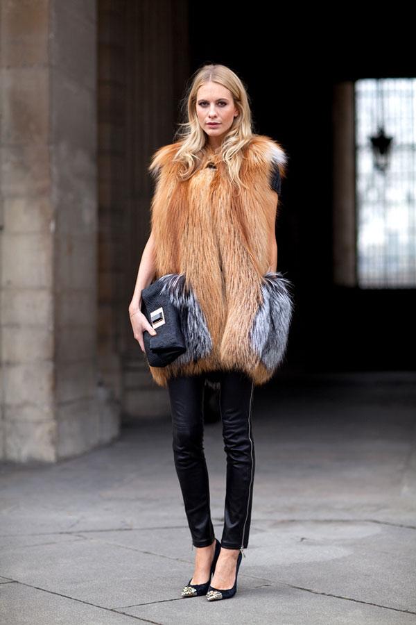 Poppy Delevigne wearing a super fur vest overtop leather skinnies with snakeskin cap-toed heels.