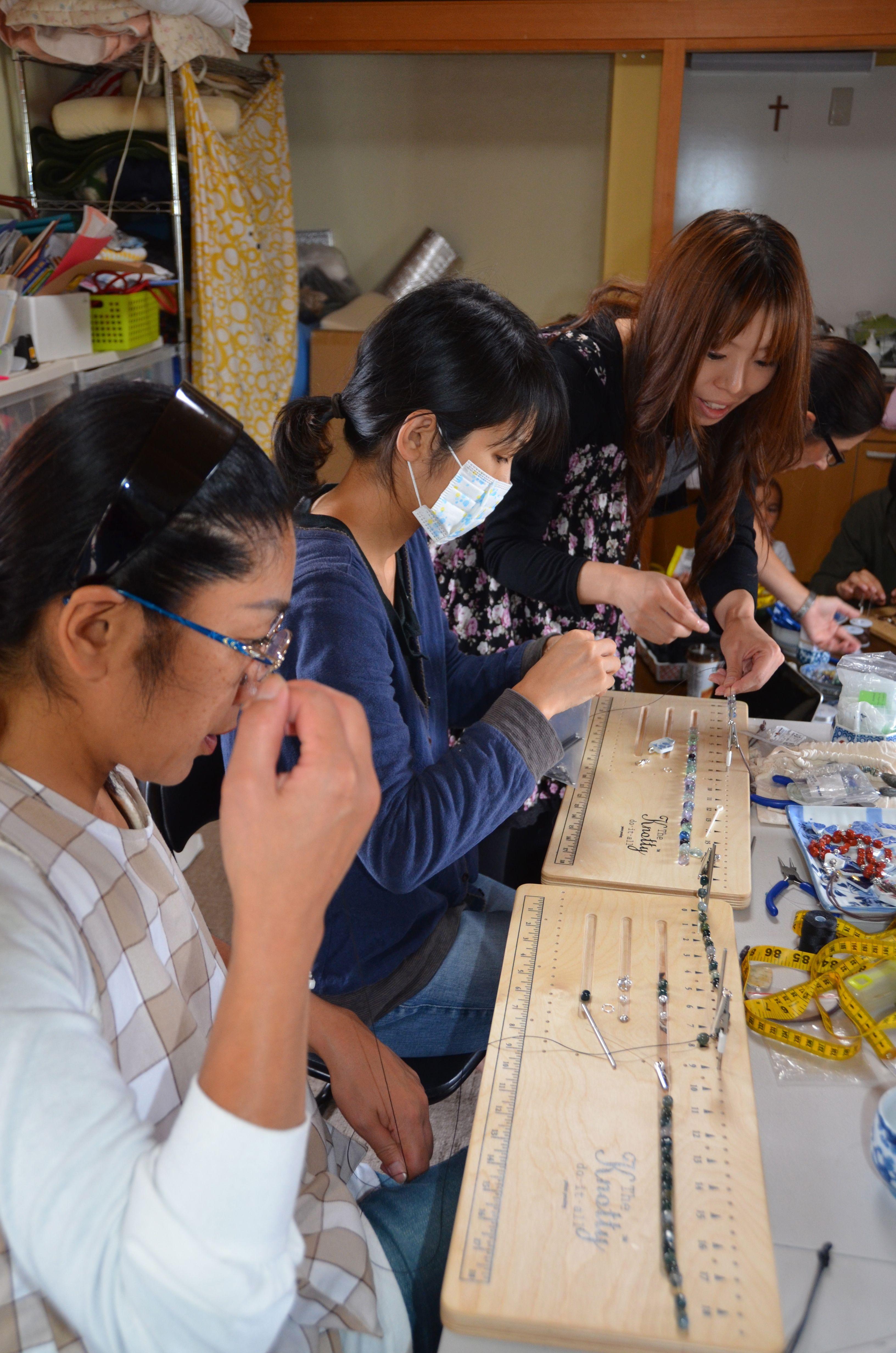 nozomi project Ishinomaki japan women making jewelry for relief