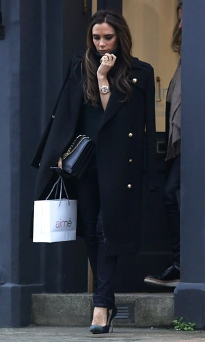 Victoria-Beckham Aime carrying oversized clutch bag pea coat new york fashion week