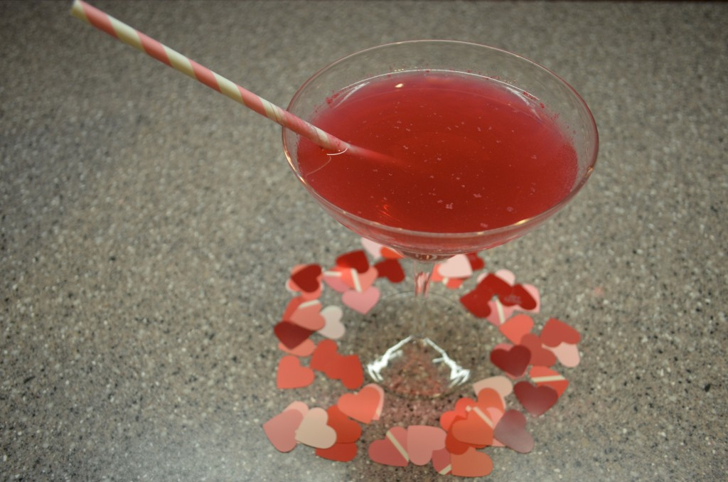 heart shaped confetti decorates red cocktail valentines day 2