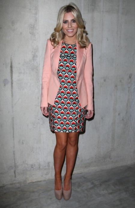 Molly Kings wears pastel pink Reiss Blazer in London