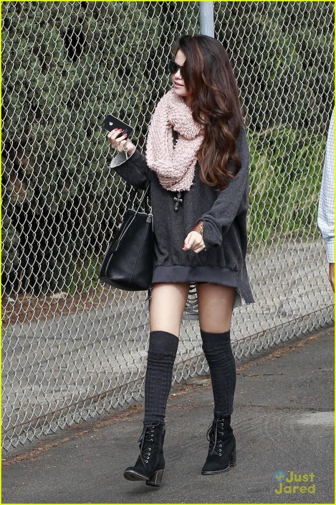 Selena Gomez wears a pastel pink infiniti scarf