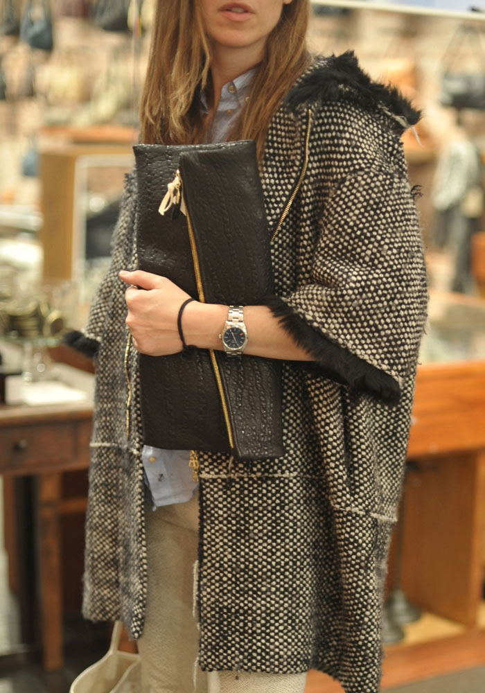 what to wear to fashion week black foldover oversized clutch and tweed coat