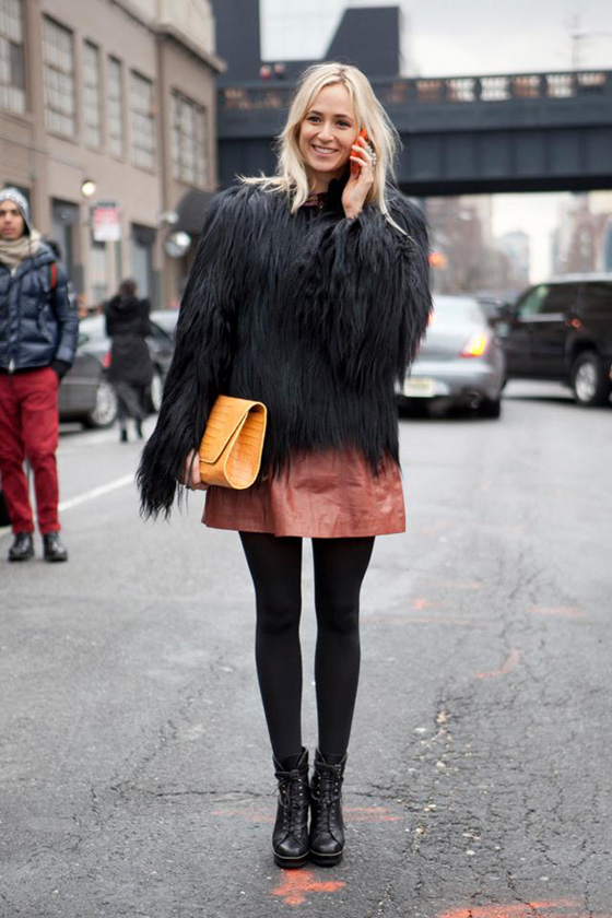 what to wear to new york fashion week oversized clutch leather skirt boots
