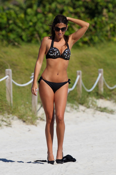 Claudia Romani balances her large bust bikini body with a top with larger straps.