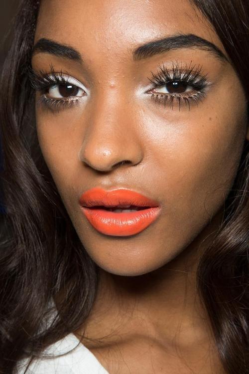 Jourdan Dunn shows of bright orange lipstick for summer