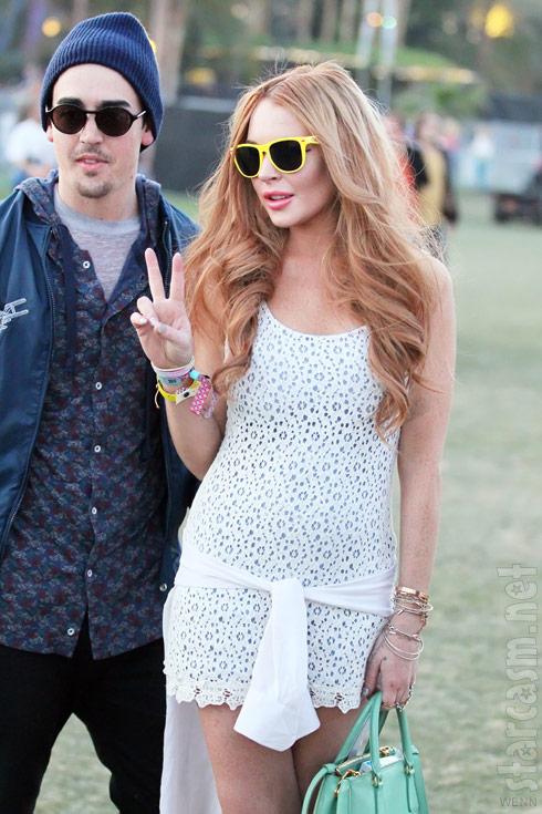 Lindsay Lohan wears yellow sunglasses at Coachella