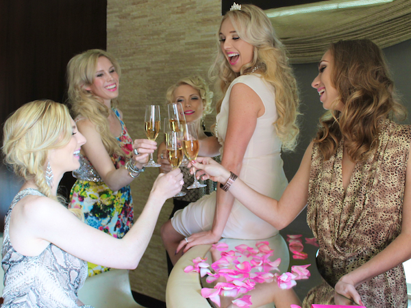 bachelorette party ideas - champagne toast at Andaz Rockstar suite san diego 1