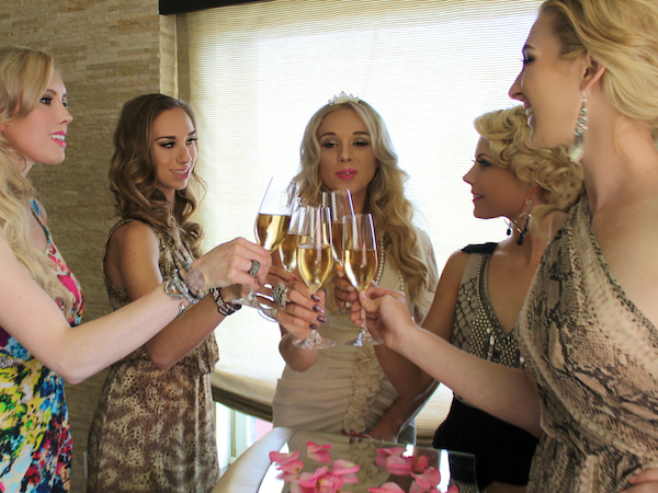 bachelorette party ideas - champagne toast at Andaz Rockstar suite san diego 3