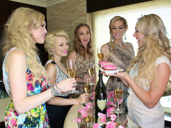 bachelorette party ideas - champagne toast at Andaz Rockstar suite san diego 5