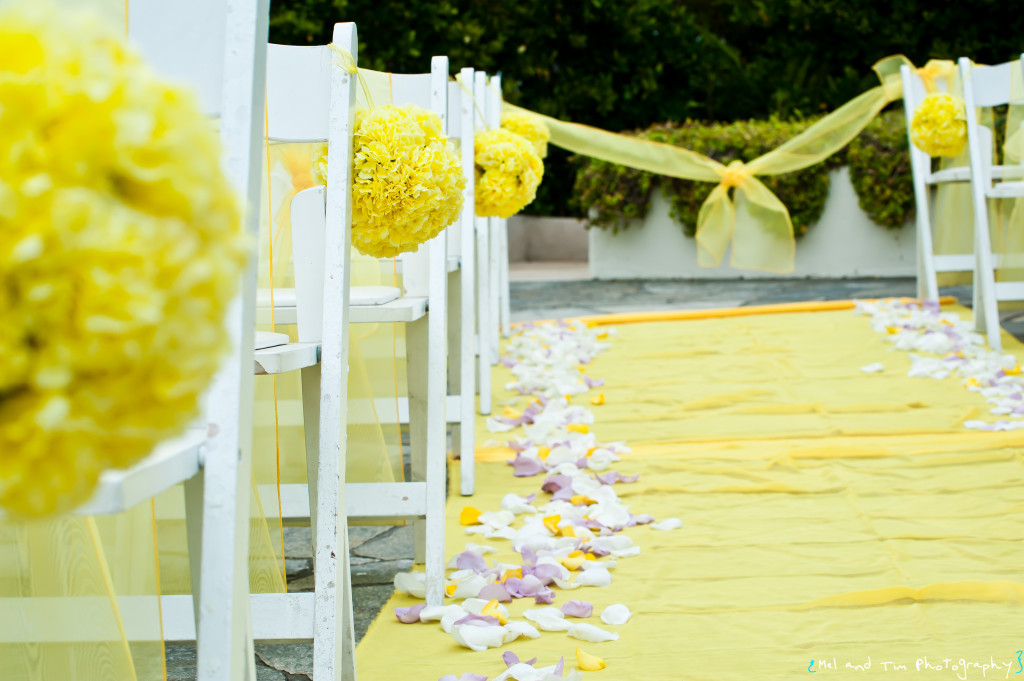 Flower Arrangements on Chair Backs, closest to aisle, for ceremony