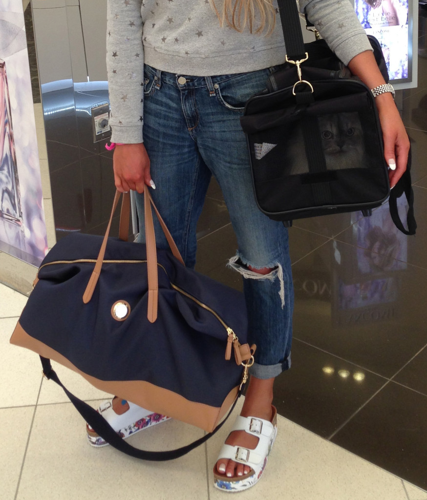 packing list essentials for airport - Tommy Hilfiger duffle bag!
