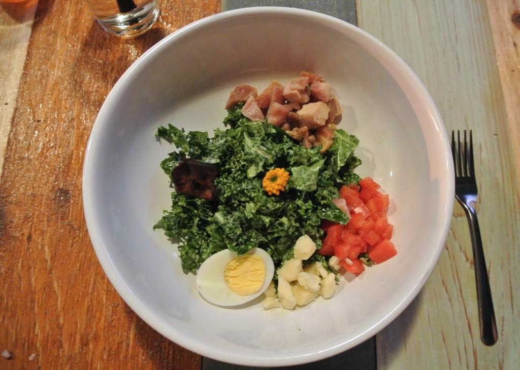 Family-Style Salad: Kale Kobb. Ingredients: Slightly Smoked Chicken, Tomato, Egg, House Farmers Cheese, Bacon, Avocado Goddess.