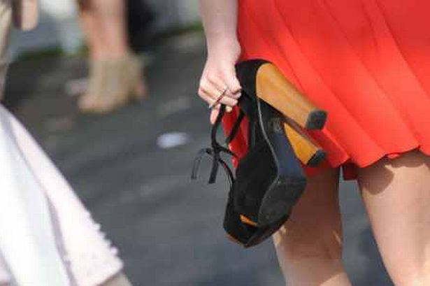 walking with heels in hand - stiletto ouch