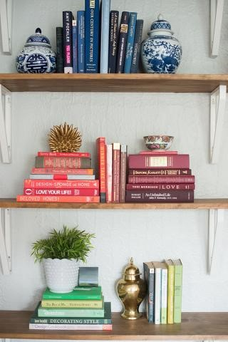 Arrange books by color to add vibrancy to wall