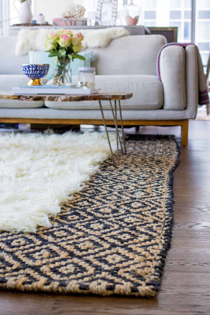 layered-rugs or contrasting textures
