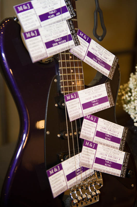 music themed wedding with concert tickets as place settings