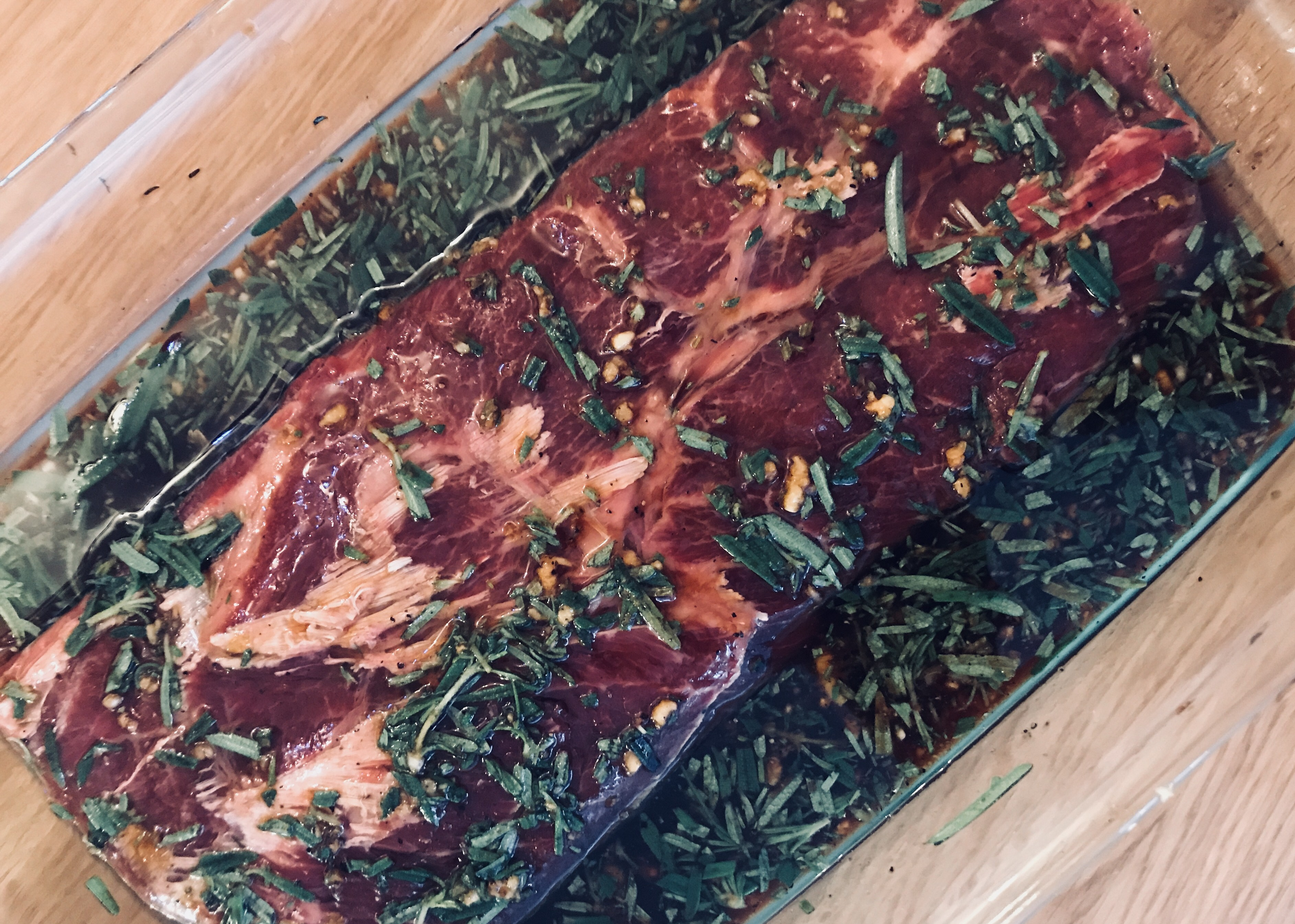 marinated grass fed flank steak in fresh rosemary