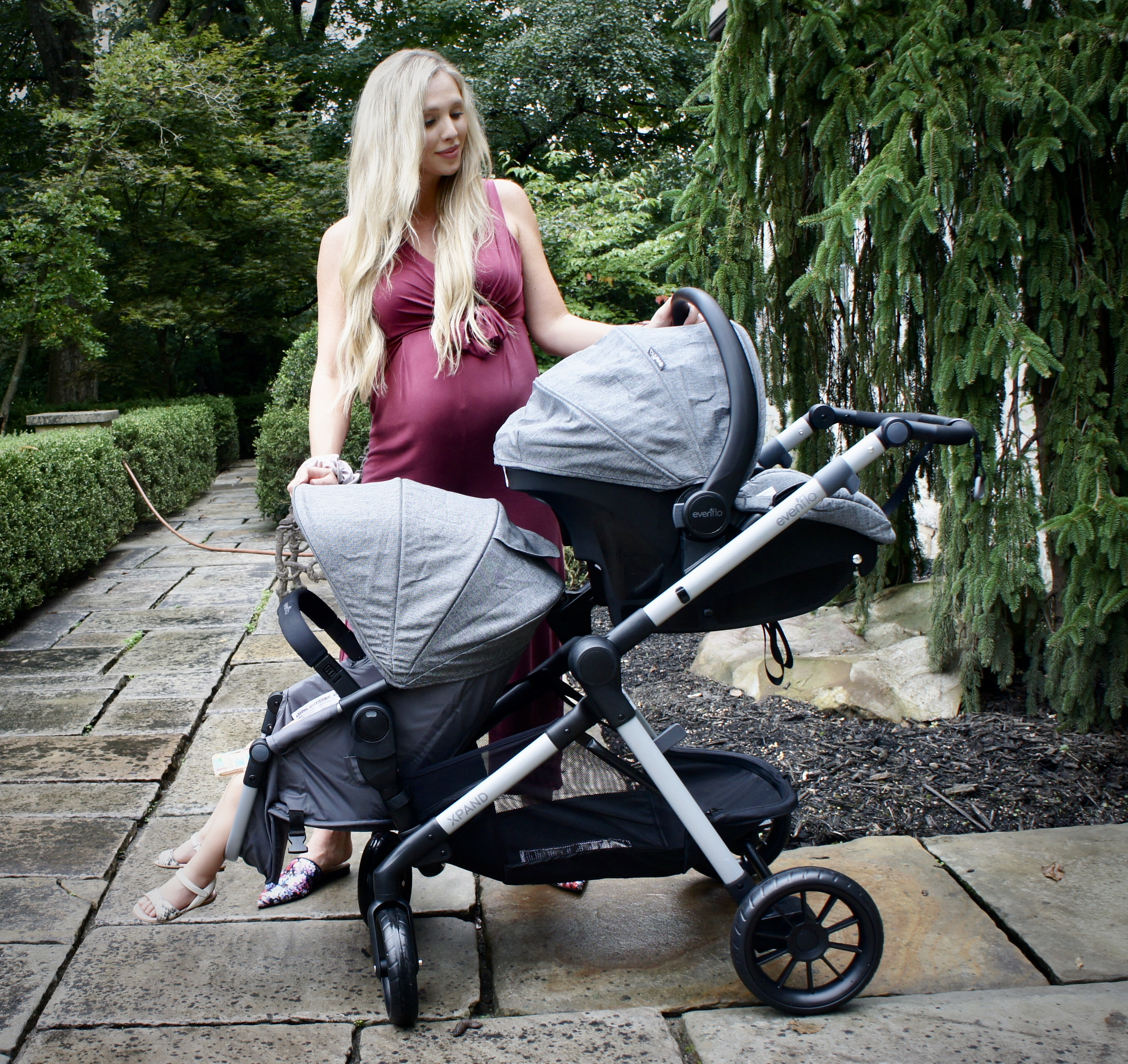 Evenflo Pivot Xpand double stroller with infant car seat and bassinet